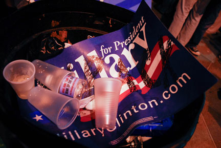 hillary sign in trash can